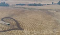 After Washington school shooting, farmer pays respect in field