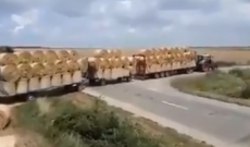 One tractor hauls more round bales than you'd probably believe