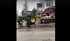 John Deere tractor carries farmer to his final resting place